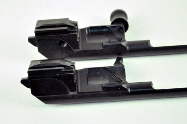 new bolt carrier and original comparison left side b med.jpg